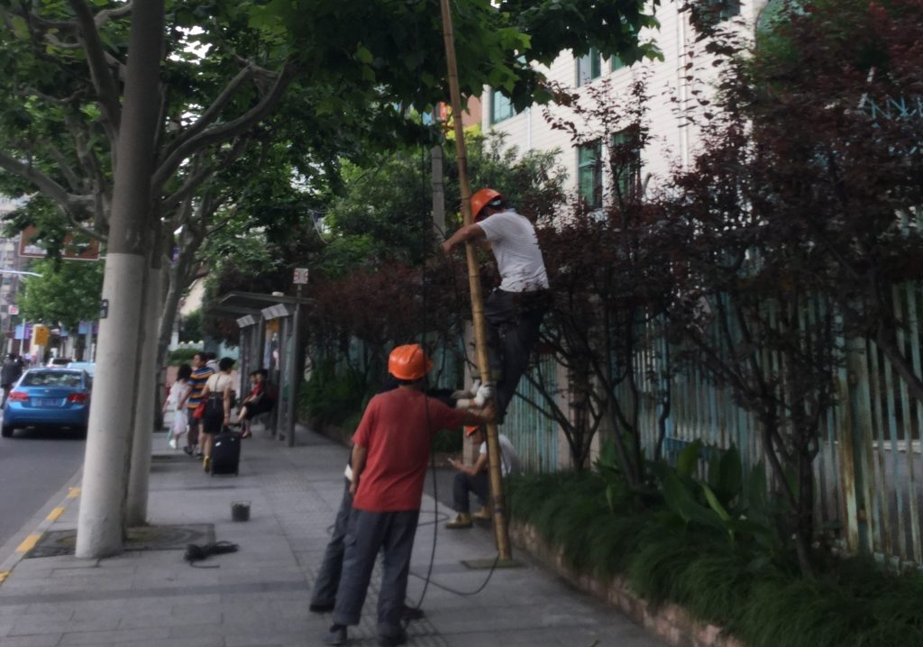Workers defying gravity on a Shanghai street corner