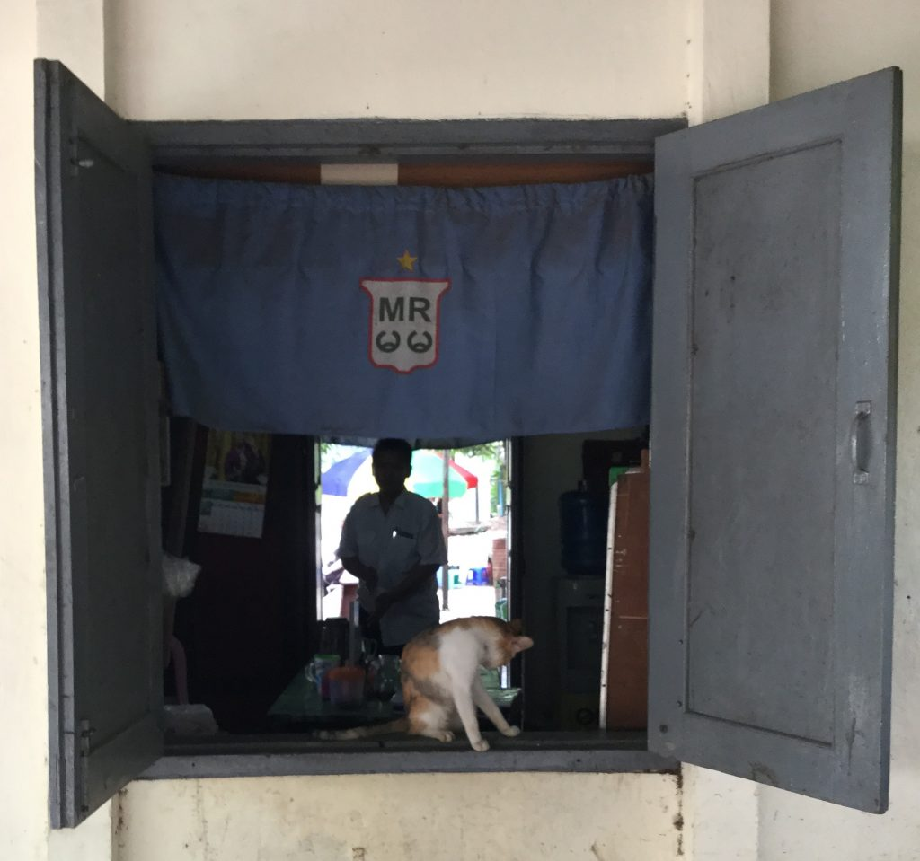 A Cat Guards a Circle Train Ticket Booth in Yangon